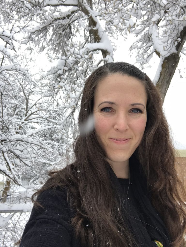 Woman smiling in snowy forest