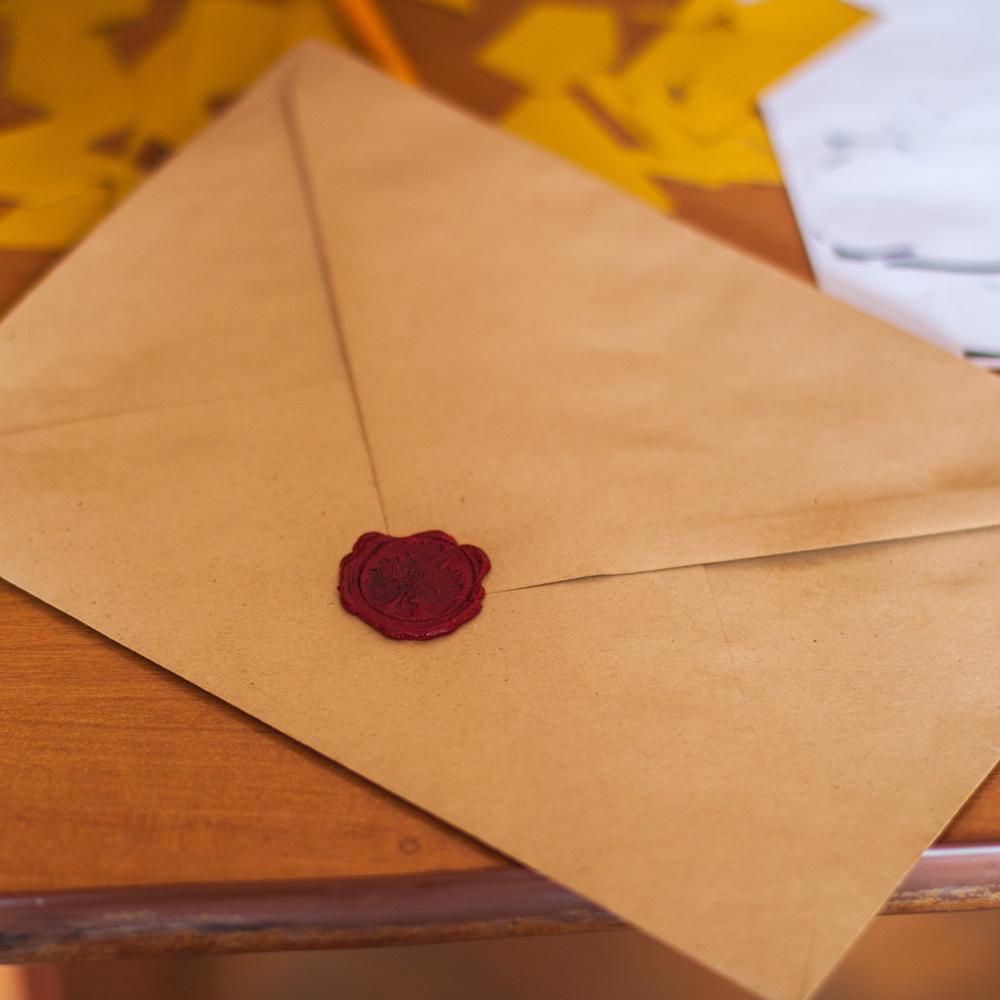 Brown envelope on kitchen table