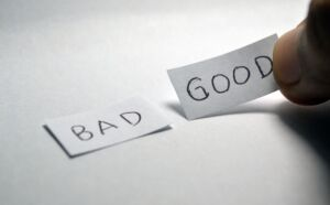 """""""Bad"""" and """"Good"""" written on two pieces of paper"""