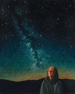 Elderly woman with headscarf looking up at night sky.