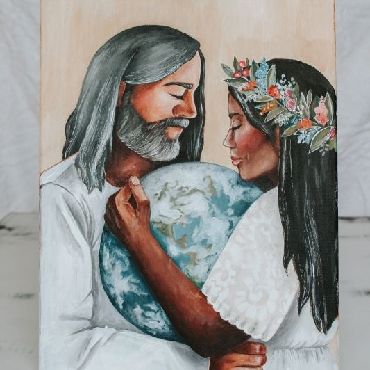 Man and woman of color wearing white clothing holding earth between them