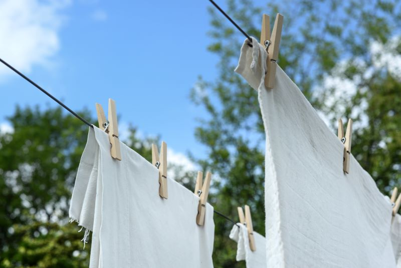 White towels hanging from clothesline