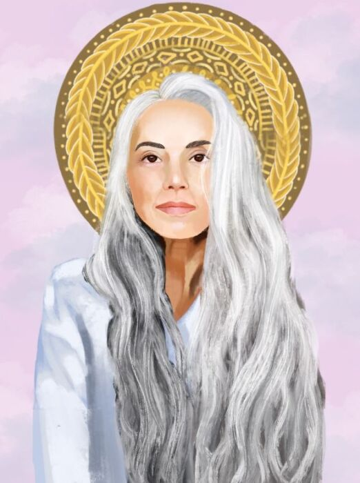 White woman with long gray hair and golden halo