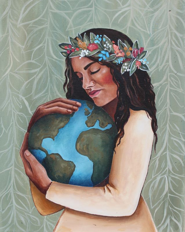 Woman of color wearing flower crown and holding earth in her arms