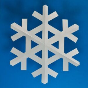 White paper snowflake on blue background