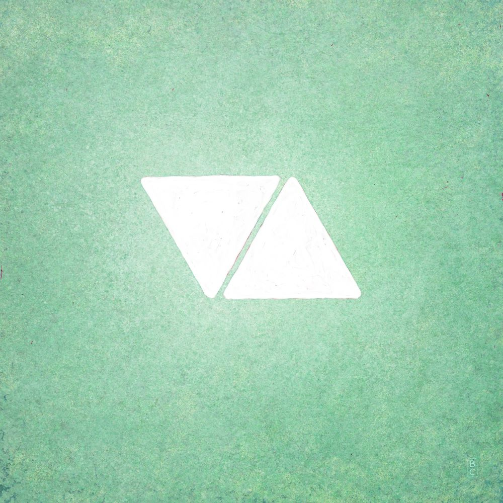 Two white triangles on pale green background