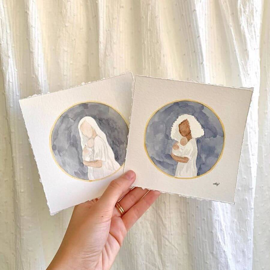 Two watercolor paintings of women clothed in white cradling babies