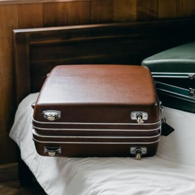 Suitcase on a bed