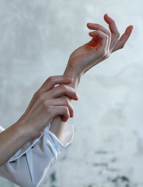 White hands in front of white background